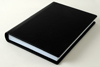 Upright book with standard cover in black:   Cover �60